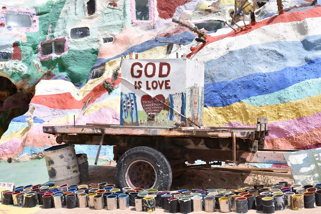 A truck that is filled with graffiti